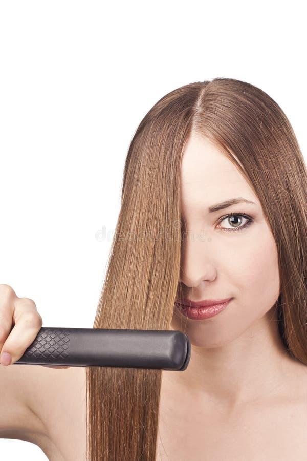 Härlig ung kvinna med långt hår royaltyfri foto