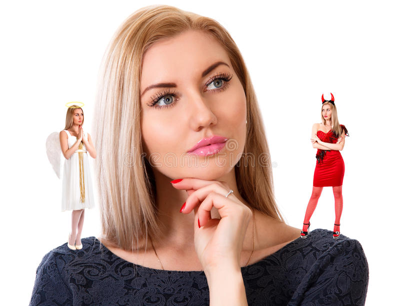 Härlig ung kvinna med liten ängel och demon royaltyfria foton