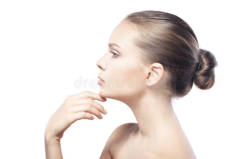 Härlig ung kvinna med ren hud som isoleras på vit royaltyfria foton