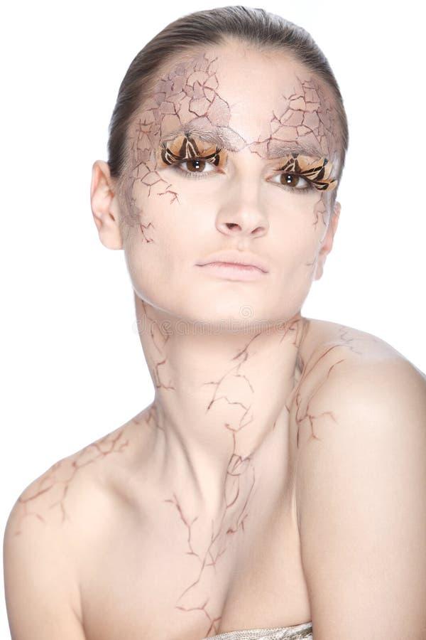 Härlig ung kvinna med stylezed facepaint royaltyfri fotografi