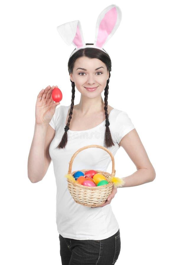 Härlig ung kvinna som den easter kaninen arkivfoto