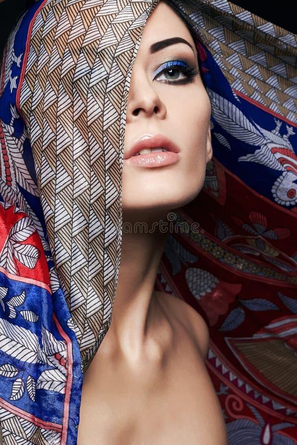 Härlig ung kvinna under huven royaltyfria foton