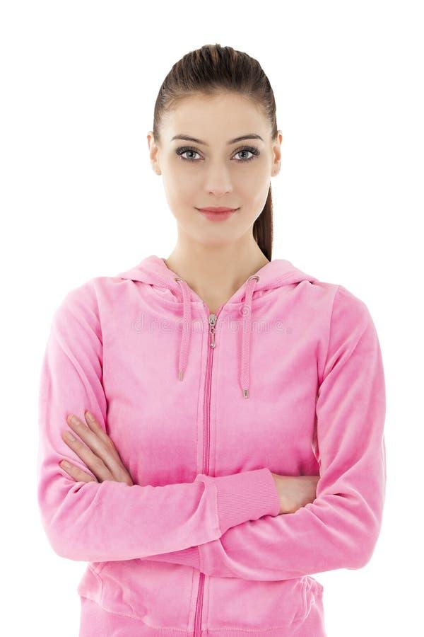 Härlig ung le kvinna i träningsoverall royaltyfria foton
