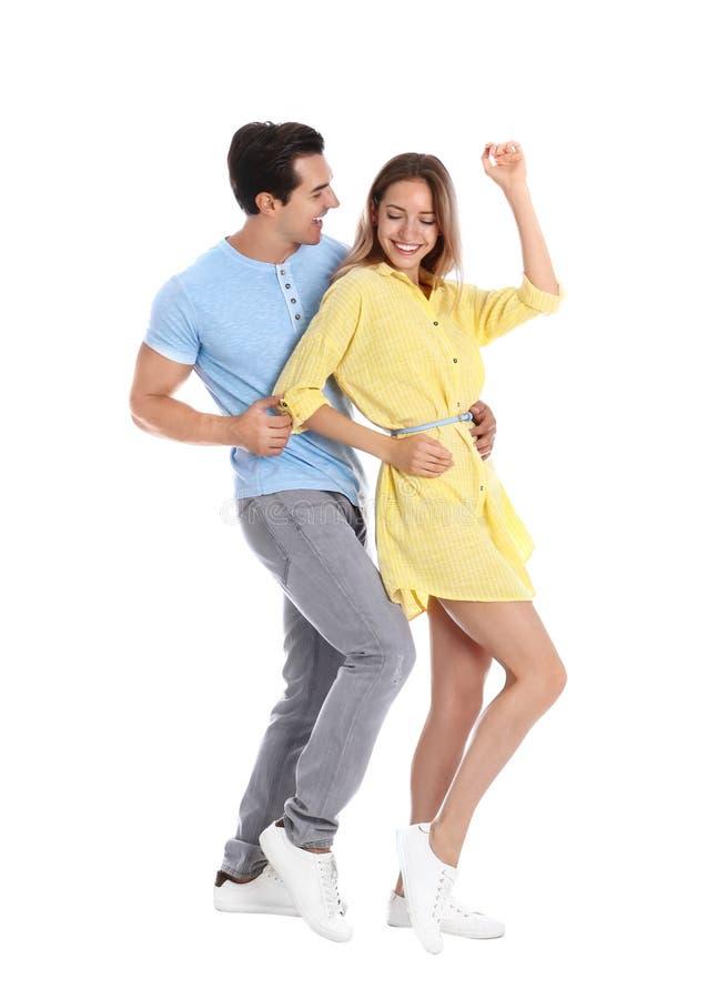 Härlig ung pardans på vit arkivfoto