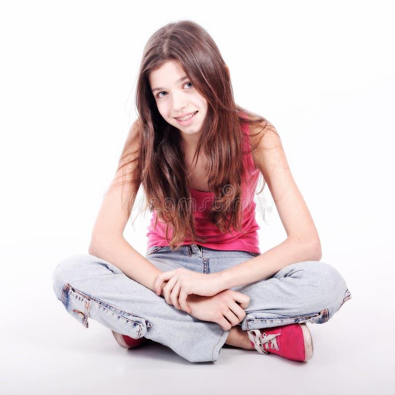 Härlig ung teen flicka med konsoler royaltyfri fotografi