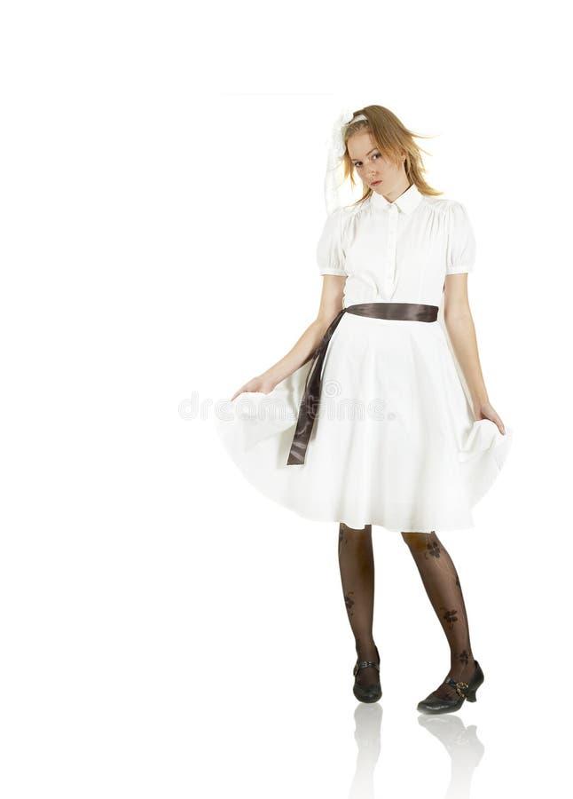 härlig white för stand för flir-flickakappa royaltyfri foto