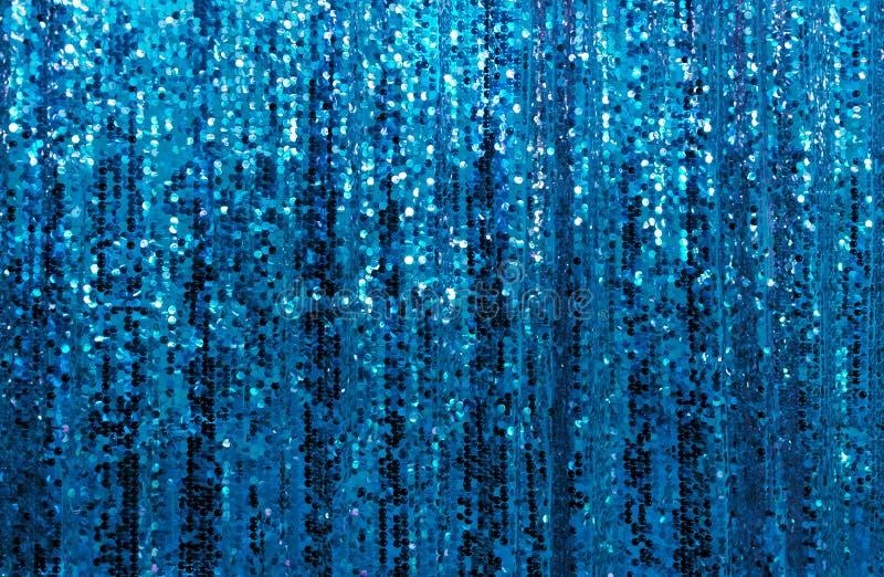 Härliga blått blänker mousserande sequined gardinbakgrund royaltyfri foto