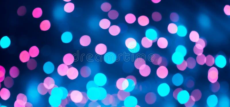 Härliga Bokeh rosa färger och blå ljus bakgrundstextur arkivfoton