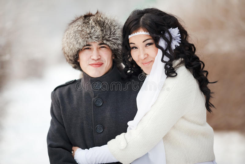 Härliga brölloppar, asiatisk brud och brudgum royaltyfria foton