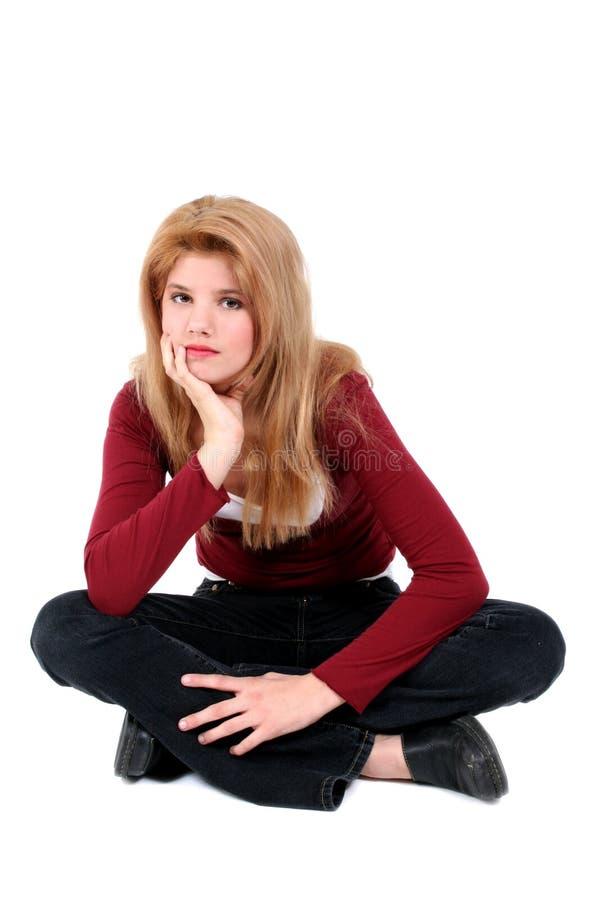härliga korsade flickaben som sitter teen white royaltyfria bilder