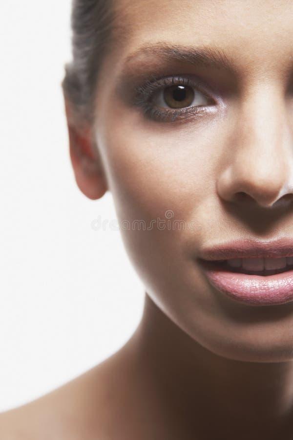 Härliga kvinnas framsida arkivfoto
