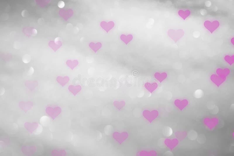 Härliga rosa hjärtor på silverbokehbakgrund royaltyfri bild