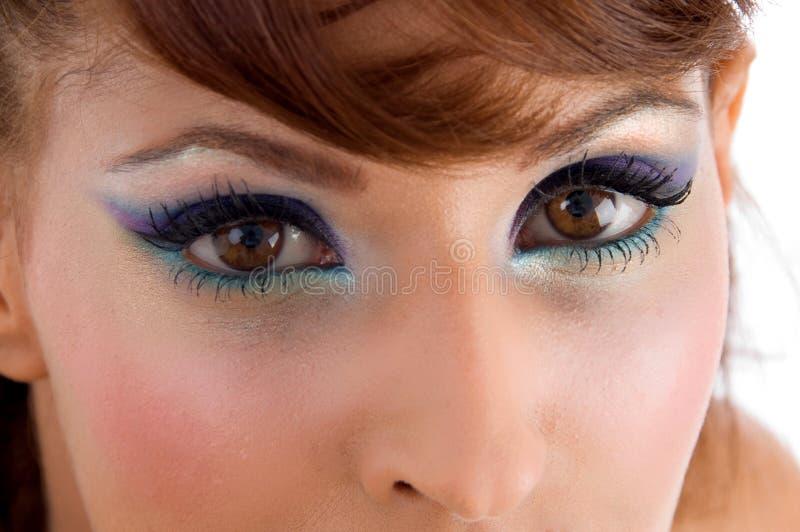 härliga täta ögon up kvinnan arkivbild