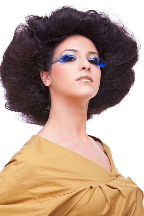 härliga unga frisyrsminkkvinnor royaltyfri bild