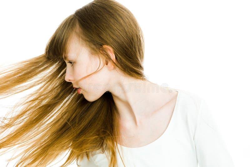 Härliga unga tonåriga flickor med långa blonda raka hår - hår på rörelse arkivfoton