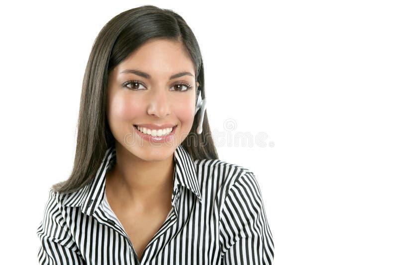 härligt affärskvinnahörlurar med mikrofonsamtal arkivfoto