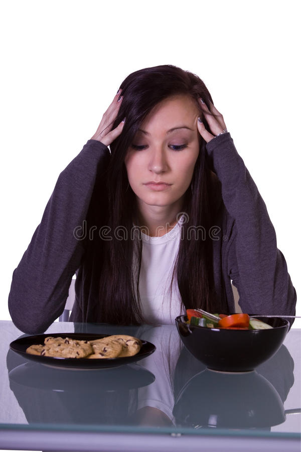härligt avgöra äter flickan till vad royaltyfri foto
