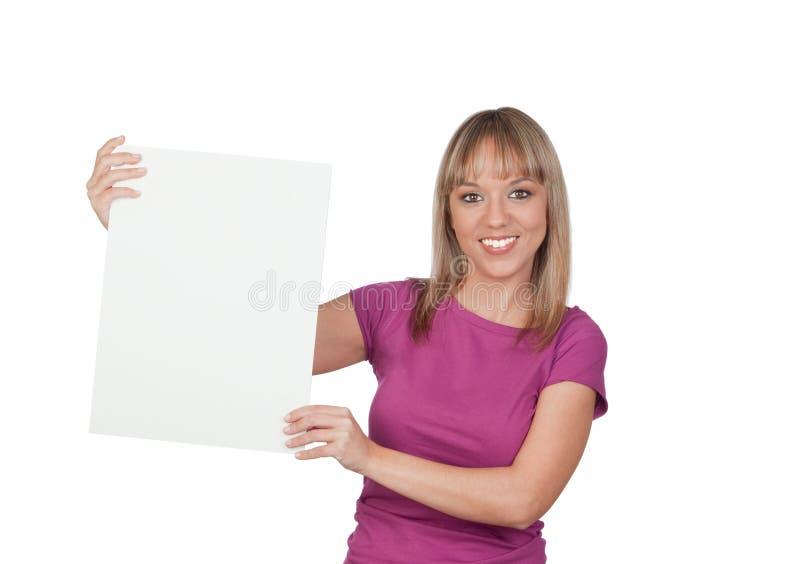Härligt flickainnehav en tom affisch för annonsering arkivfoton