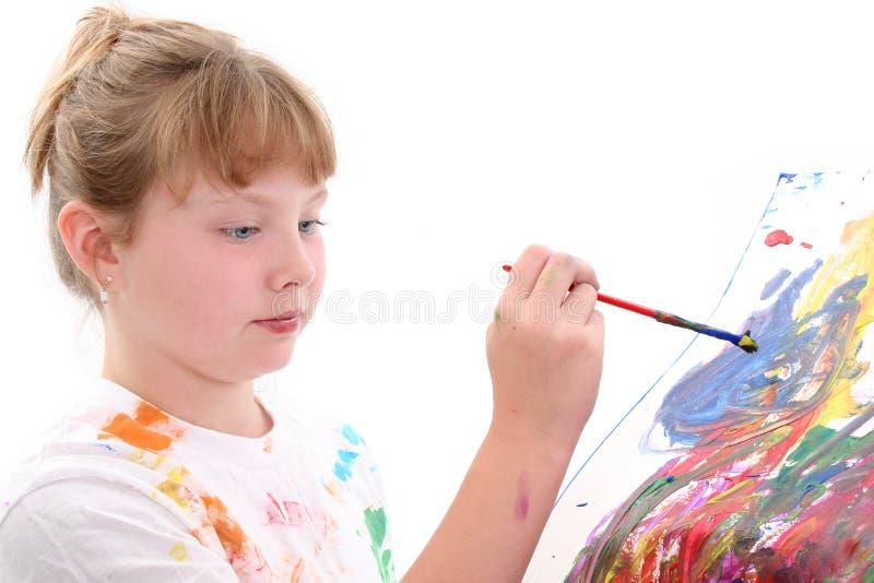 härligt flickamålningsbarn arkivbilder