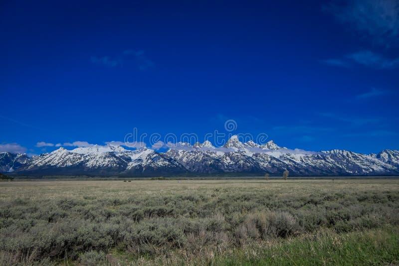 Härligt landskap av det storslagna Tetons området och maxima som lokaliseras inom den storslagna Teton nationalparken, Wyoming so arkivfoton