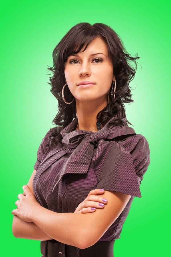 härligt mörkt haired ståendekvinnabarn arkivfoto