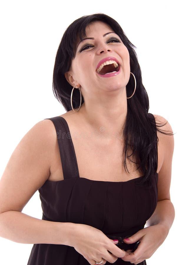 härligt skratta för lady arkivfoto