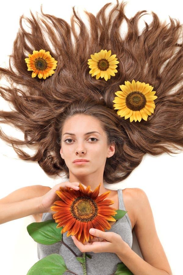 härligt spritt kvinnabarn för hår long royaltyfri foto