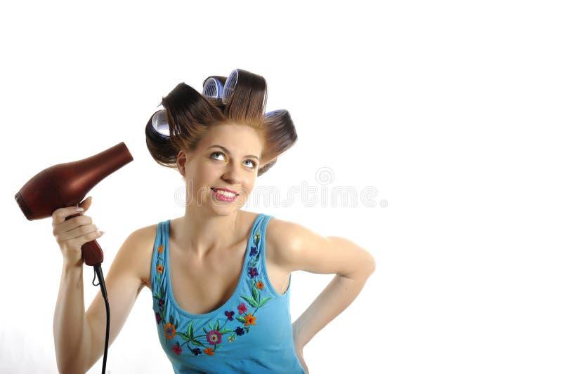 härligt torkande hår henne kvinnabarn royaltyfria bilder
