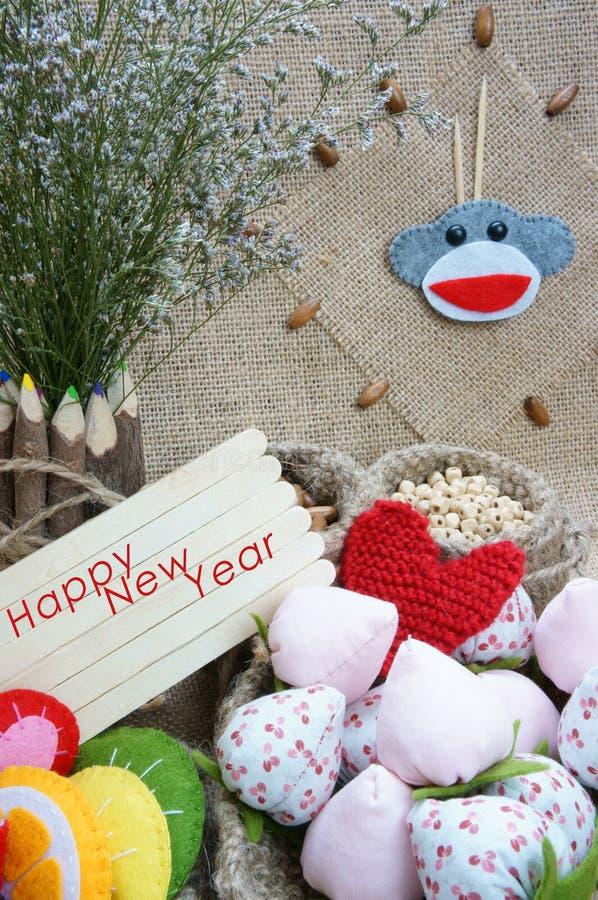 Härma det lyckliga nya året 2016, tid, klockan, handgjord frukt royaltyfria bilder