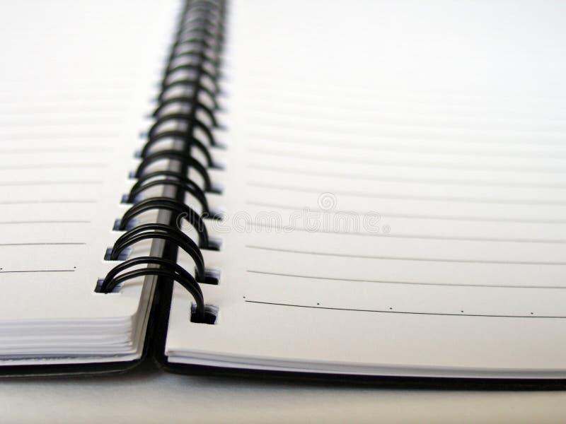 härskad öppen cirkel för anteckningsbok arkivbild