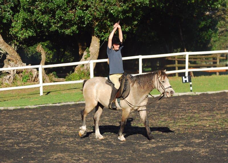Häst- terapiflicka på häst royaltyfria foton
