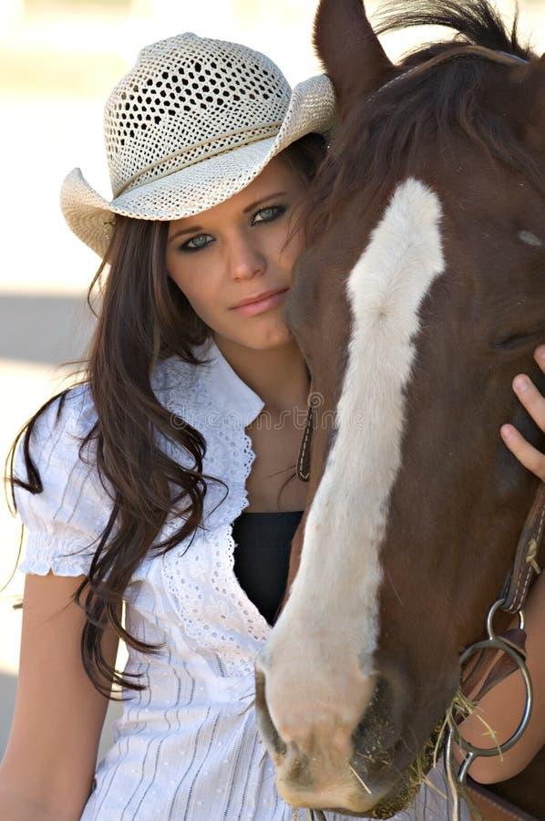 hästkvinnabarn royaltyfri foto