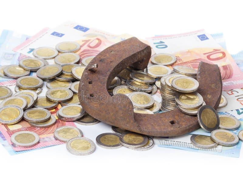 Hästskor och euro fotografering för bildbyråer