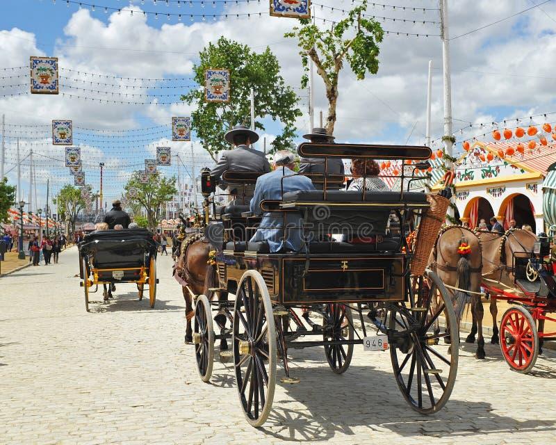 Hästvagn i den Seville mässan, Andalusia, Spanien arkivbild