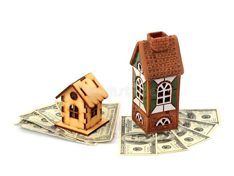 Häuser und Dollar lizenzfreie stockfotografie