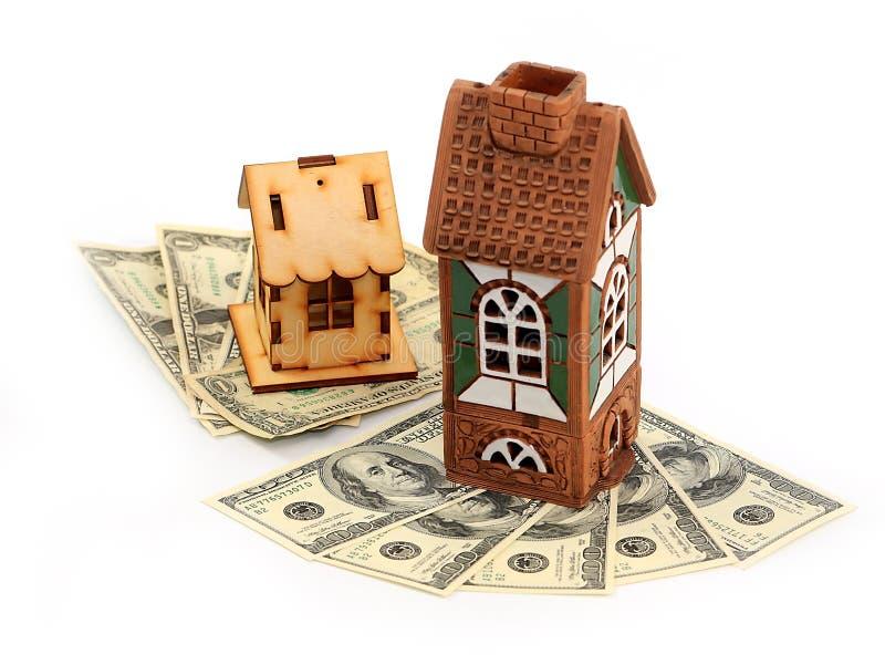 Häuser und Dollar lizenzfreies stockbild