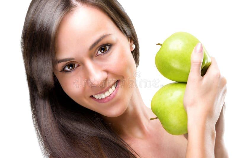 Hållande äpplen för Healthful äta-härlig kvinna, närbildfoto arkivfoton