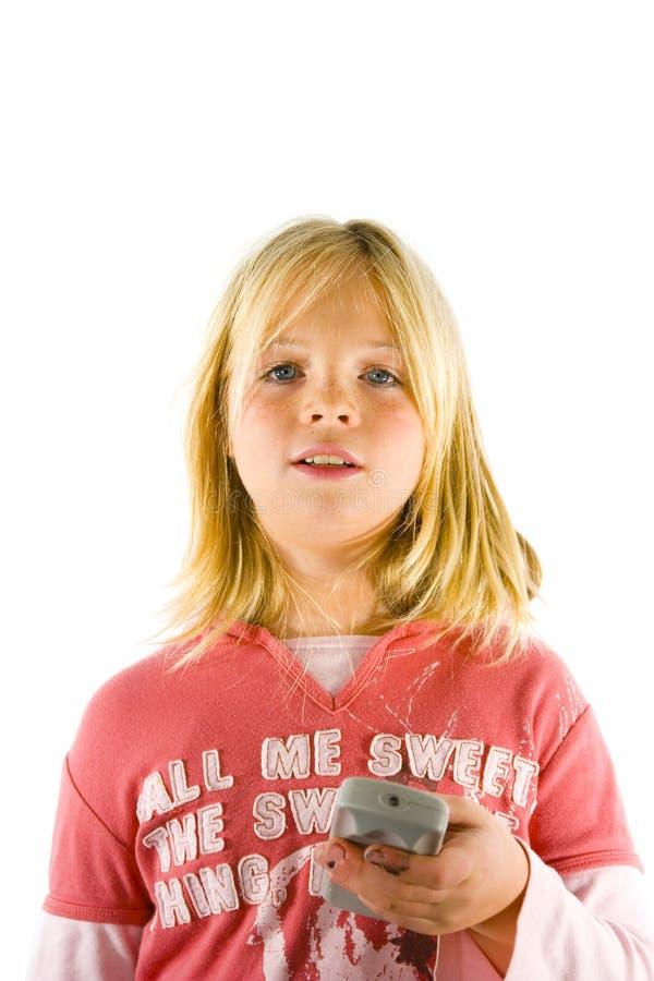 hållande ögonen på barn för flickatv royaltyfria foton