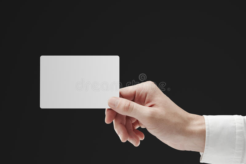 Hållande affärskort för hand, informationsbegrepp royaltyfri foto