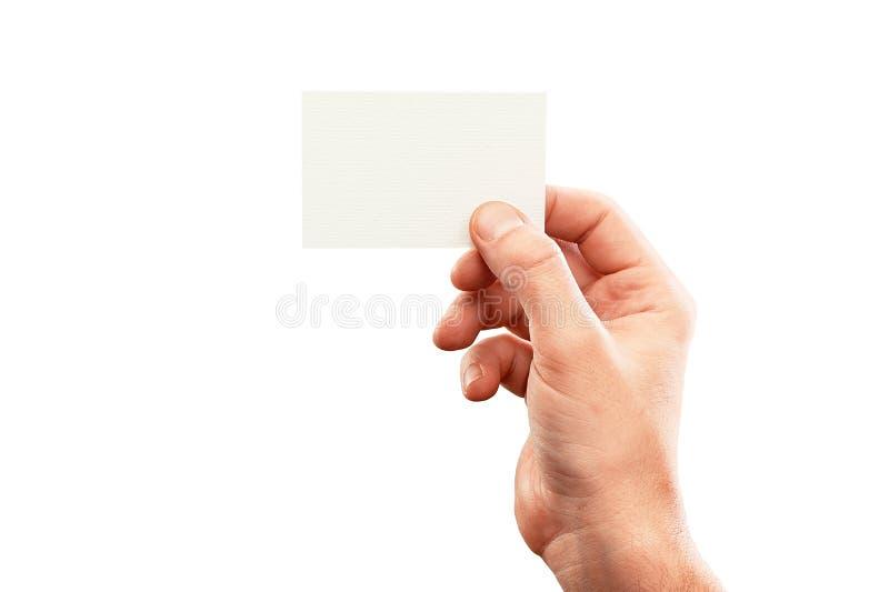 Hållande affärskort för manlig hand, modell på vit arkivfoton