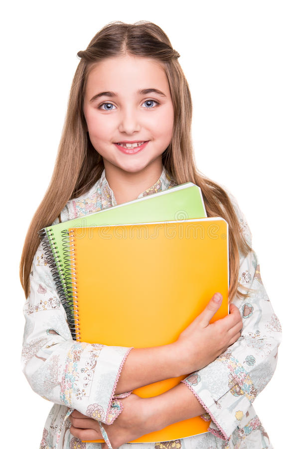 Hållande anteckningsbok för liten student arkivfoto