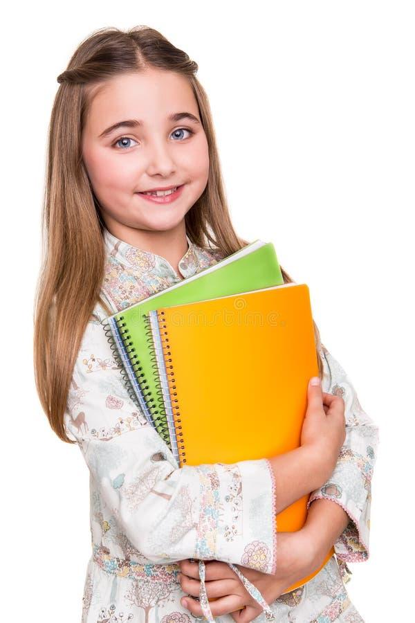 Hållande anteckningsbok för liten student fotografering för bildbyråer