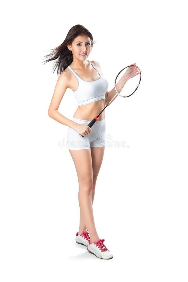 Hållande badmintonracket för ung asiatisk kvinna, fotografering för bildbyråer