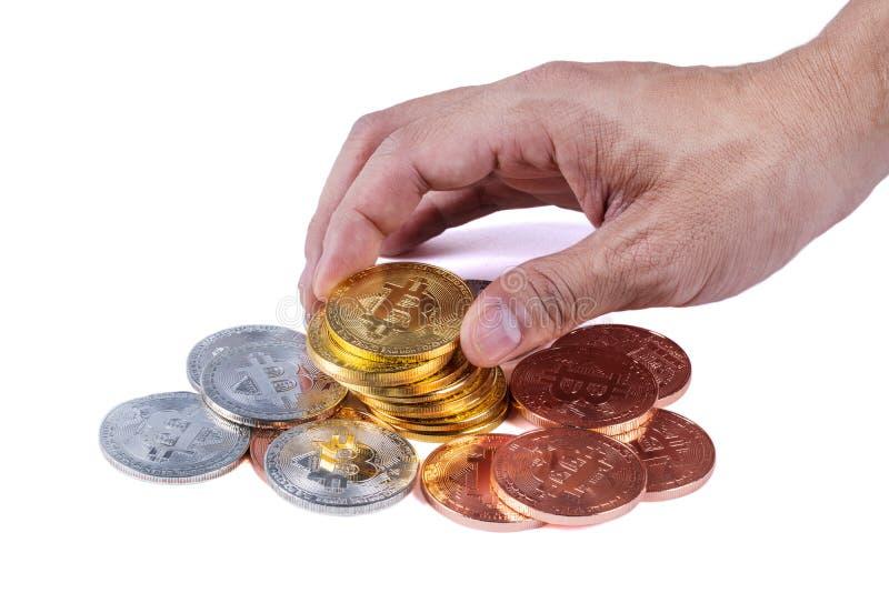 Hållande bitcoin för hand som isoleras på vit bakgrund royaltyfria bilder