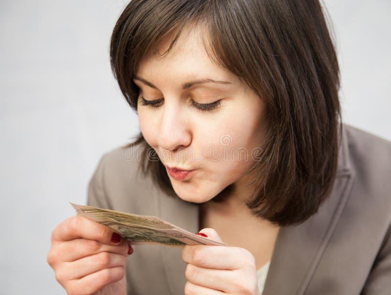 Hållande dollar för affärskvinna arkivfoton