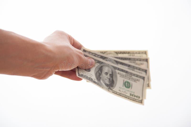 Hållande dollar för manlig hand arkivbild