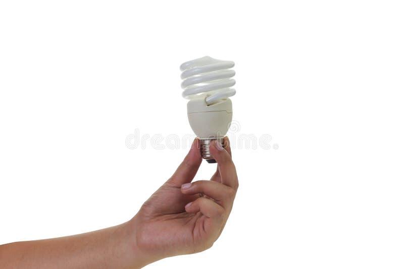 Hållande energi för hand - sparande ljus kula royaltyfri bild