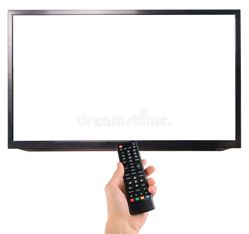 Hållande fjärrkontroll för manlig hand till TVskärmen som isoleras på vit arkivfoton