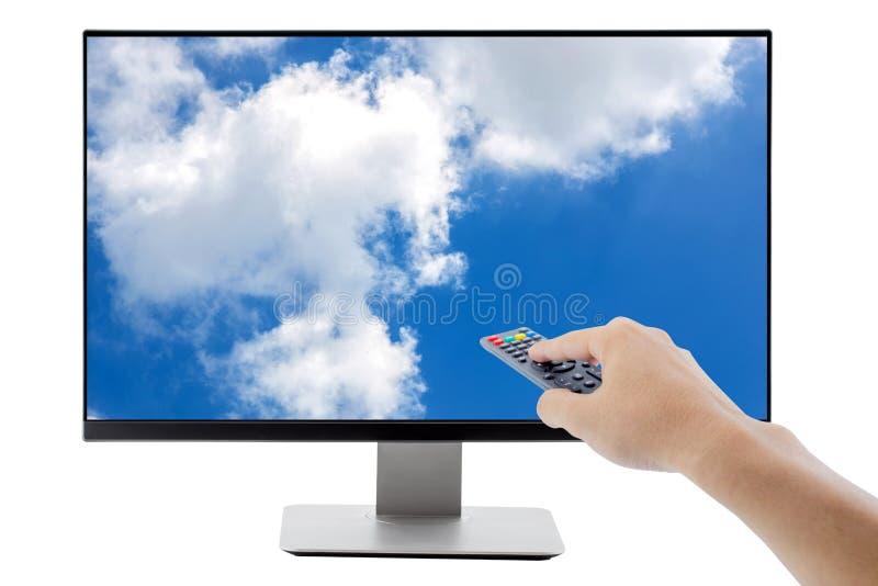 Hållande fjärrkontrollTV för hand fotografering för bildbyråer