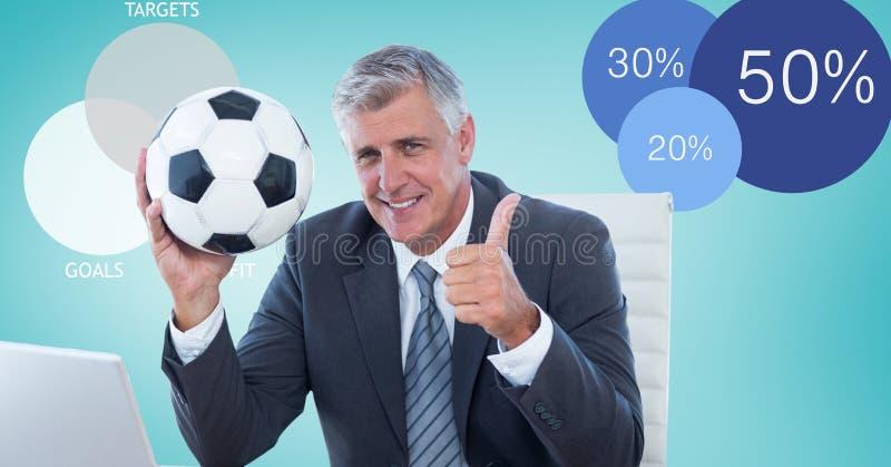 Hållande fotbollboll för affärsman, medan visa upp tummar fotografering för bildbyråer